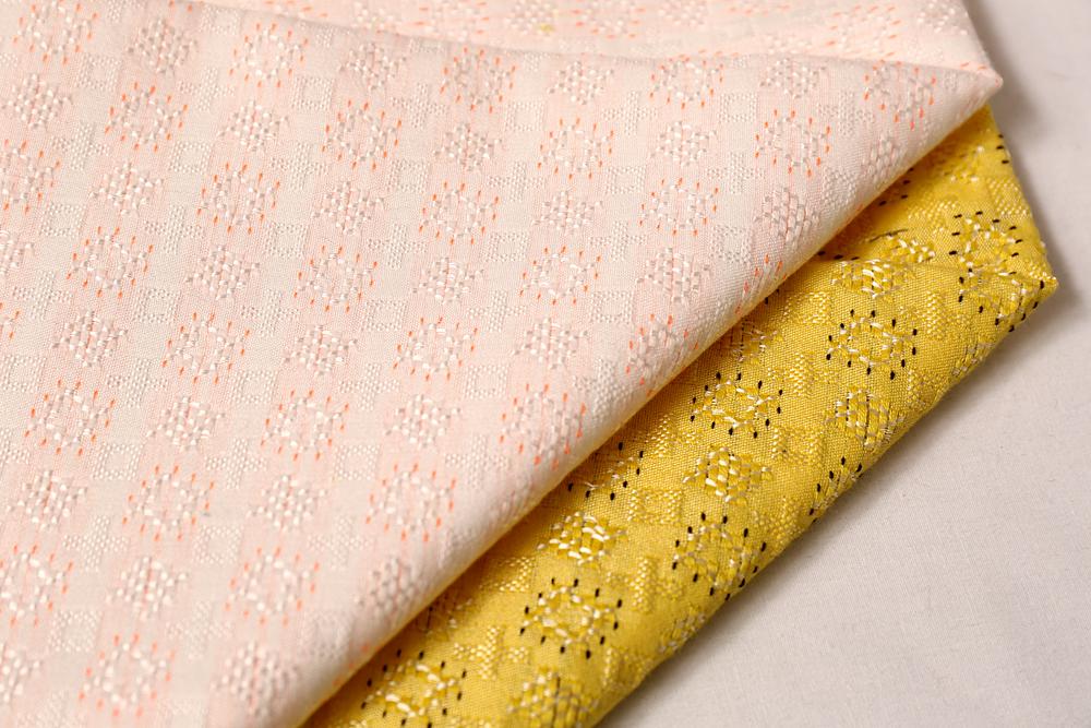 上海布衣纺2015时尚女装梭织提花面料批发
